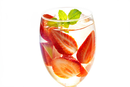 warm color: glass delicious refreshing drink of strawberry with mint on on white background, infusioned water, warm color tone Stock Photo