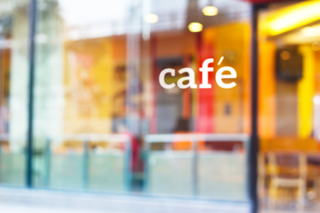 restaurant exterior: colorful and pastel coffee shop and text cafe in front of mirror for background, soft and blur concept