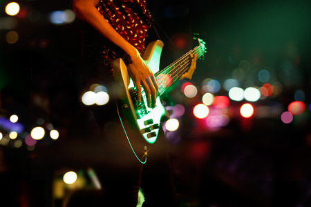 stage performer: Guitarist on stage abstract colorful background, soft and blur concept