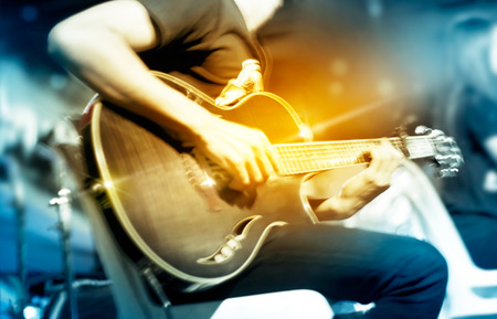 loud music: Guitarist on stage for background, vibrant soft and motion blur concept Stock Photo