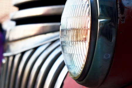 Colorful head light vintage car on dark tone, soft focus and blur photo