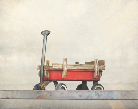 Red pull trolley toys, old rusty wagon, Vintage color tone on paper grain