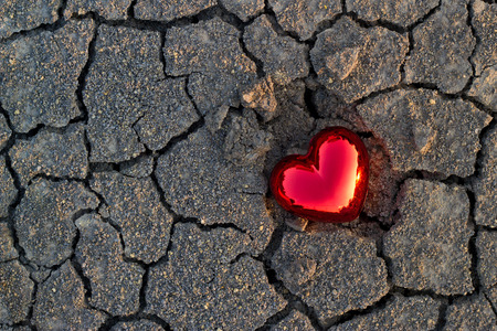 natur: abstract red heart shape on crack ground natur sunset, soft focus