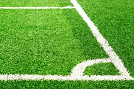 football pitch: Green soccer field grass and white corner line