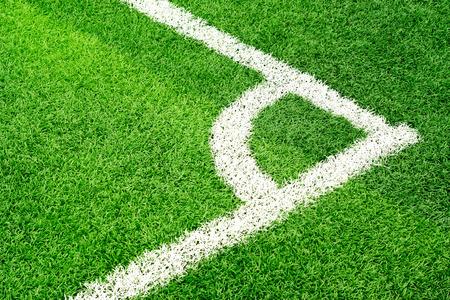 corner kick soccer: Green soccer field grass and white corner line