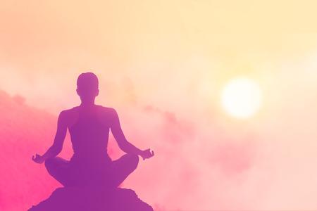 women meditating pastel on high mountain in sunset background Reklamní fotografie - 41541687
