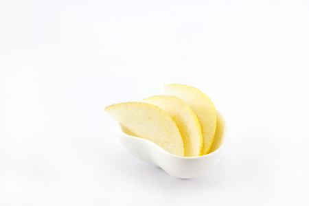 asian pear: Asian pear slice in heart shape bowl on white background