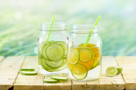 lemon water: Infused detox water, Vintage and pastel color tone, Detox diet lemon and cucumber on wooden nature background