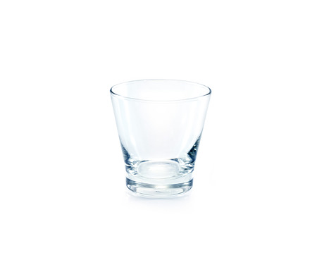 crystal glass: Empty drinking glass on white background