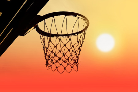 outdoor basketball court: Basketball hoop outdoor in the sunset silhouette