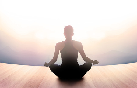 woman was meditating in morning and rays of light on landscape, vibrant soft and blur concept