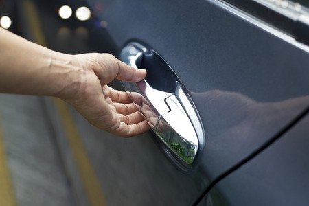 rental: Hand on handle, man opening a car door on the street