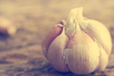 garlic: Garlic on the wooden background, Vintage color