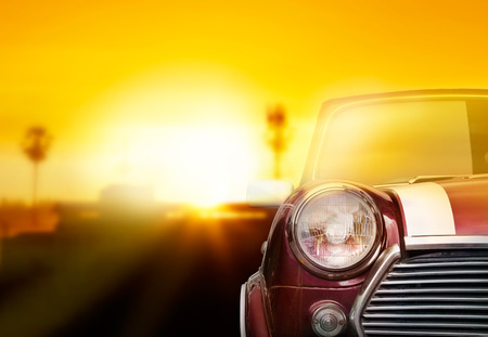 vintage car: Retro car head light on street in the sunset background
