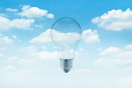 흰 구름 배경으로 푸른 하늘에 전구 빛