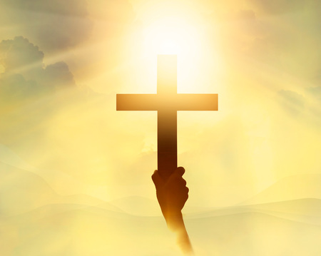 hands of light: Silhouette the cross in hand, religion symbol in light and landscape over a sunrise, background, religious, faith concept Stock Photo