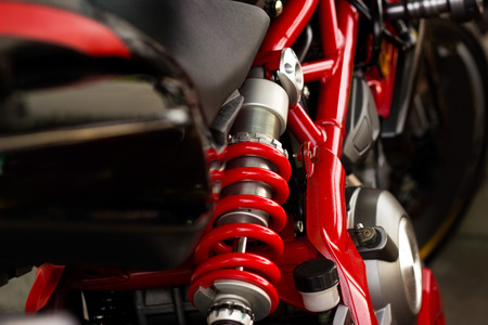 wheel: Red Shock Absorbers and frame motorcycle Stock Photo
