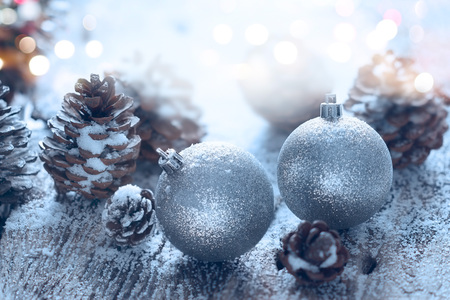 silver background: Christmas ornament pine cones; Winter background with frost fir branch