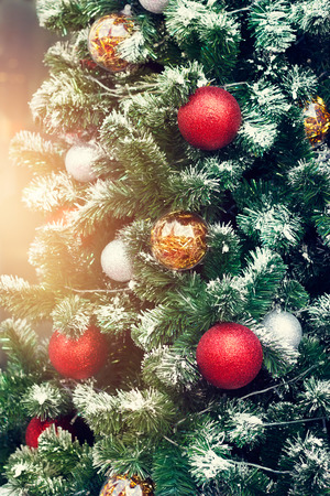 decorating christmas tree: Colorful decorating christmas tree on lighting background