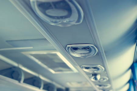 air duct: Row of airconditioning system in shuttle bus, making cool fresh air all inside the bus, soft focus