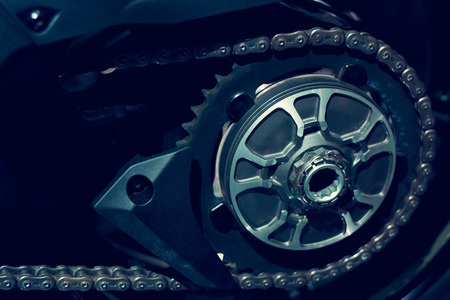 sprocket: Gear of motorcycle on dark background