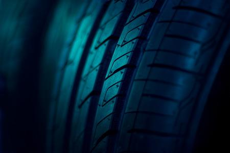 black grip: close up car tyres on dark background