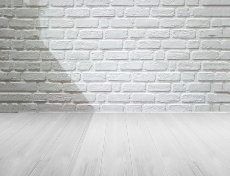 black shadow: white brick wall and wooden floor with lighting and shadow, black and white