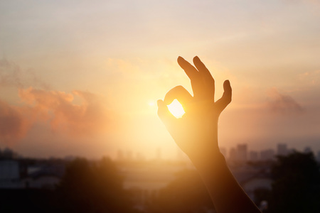 hand in the sunset, one sign of meditation in buddhism, soft focus Stock fotó