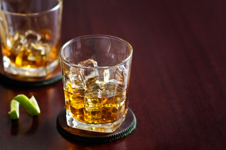 scotch whisky: whiskey in glass on wooden background, blank text Stock Photo