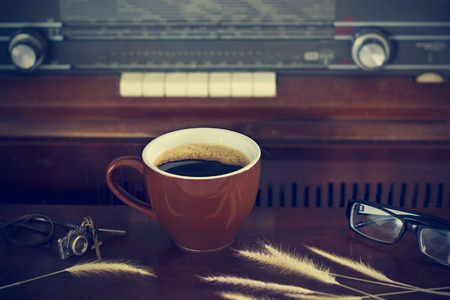 broadcast: coffee cup and retro radio background, vintage color tone