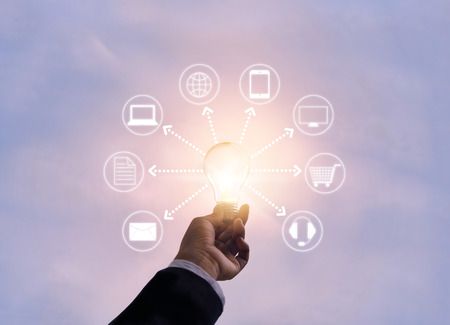 hand holding light bulb network connection, Omni Channel or Multi channel
