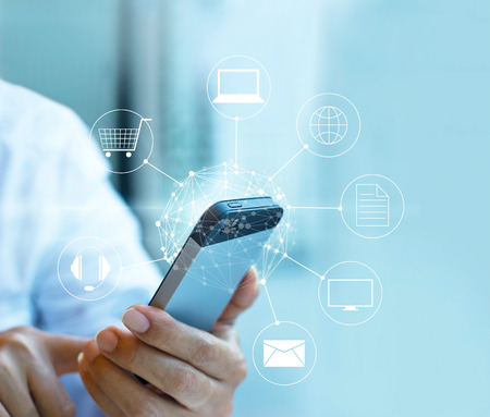 Man using mobile payment, holding circle global and icon customer network connection, Omni Channel or Multi channel Foto de archivo