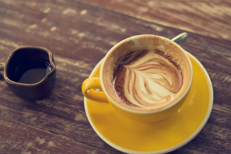 decreased: Drinking coffee was decreased to half a cup on wooden table Stock Photo