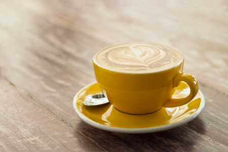 capuccino: Coffee cup on wooden background, Vintage color tone