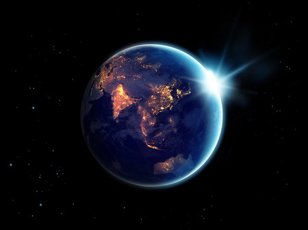 Luci della città di notte in pianeta terra con con sole che sorge,