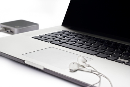 cookware: Laptop and earphone on white background