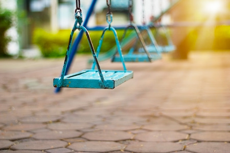 chain swing ride: Closeup of swings in the park of morning Stock Photo