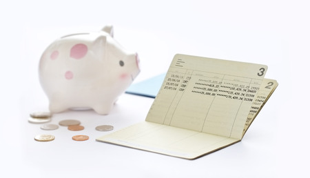 Saving account passbook, book bank and piggy bank on white background Imagens - 65036923