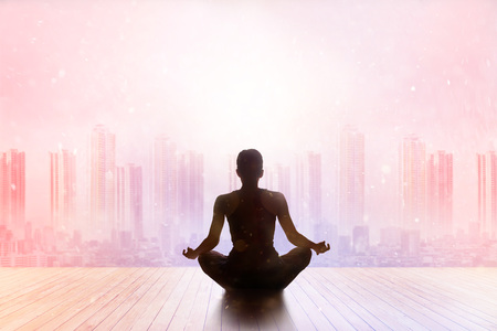 mountain sunset: woman meditating colorful pastel on high mountain in sunset background