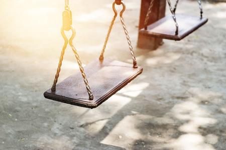 chain swing ride: Empty metal swing in playground Stock Photo