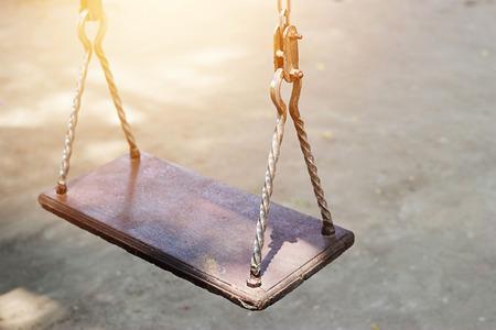Empty metal swing in playground Stock Photo