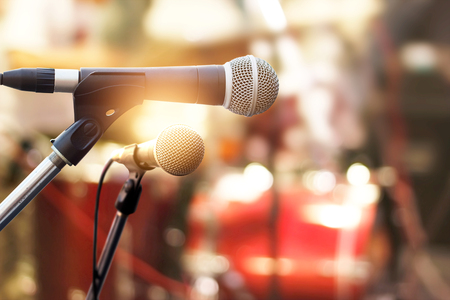Microphone on concert stage background