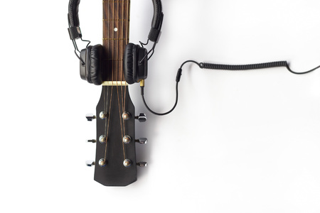 vintage objects: Guitar and headphone on the white background