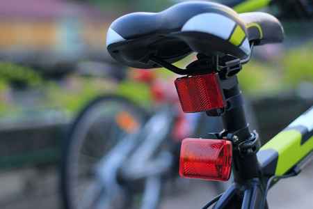 Back lights bicycle on street background Stok Fotoğraf - 74104110