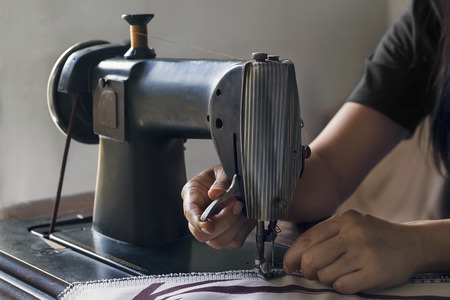 Woman With Fabric At Vintage Sewing Machine Stock Photo Picture And Awesome Vintage Sewing Machine Fabric