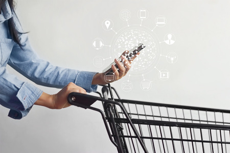 woman using mobile payments online shopping and icon customer network connection on screen, m-banking and omni channel Standard-Bild