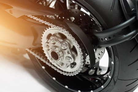detail of a motorcycle rear chain and gear Stock Photo - 76651432