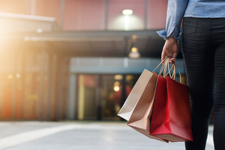 woman walking with shopping bags on shopping mall background. Stock Photo