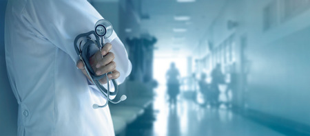 Doctor with stethoscope in hand on hospital background Stock fotó - 80150334