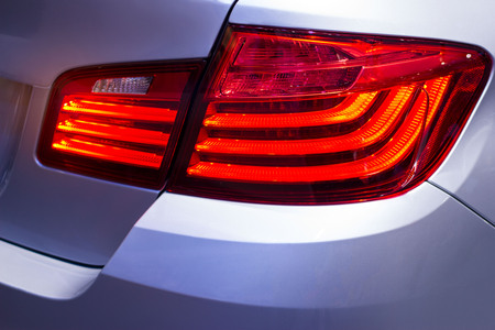 Detail on the back light of city car Stock Photo